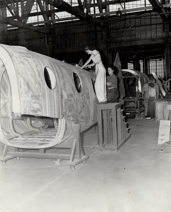 Final touches are applied to a completed fuselage
