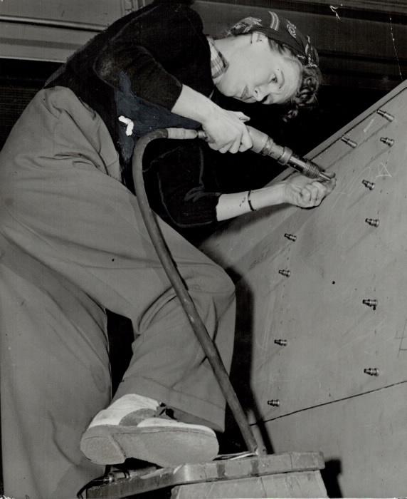 Georgina Ogilvie rivetting on a bomber